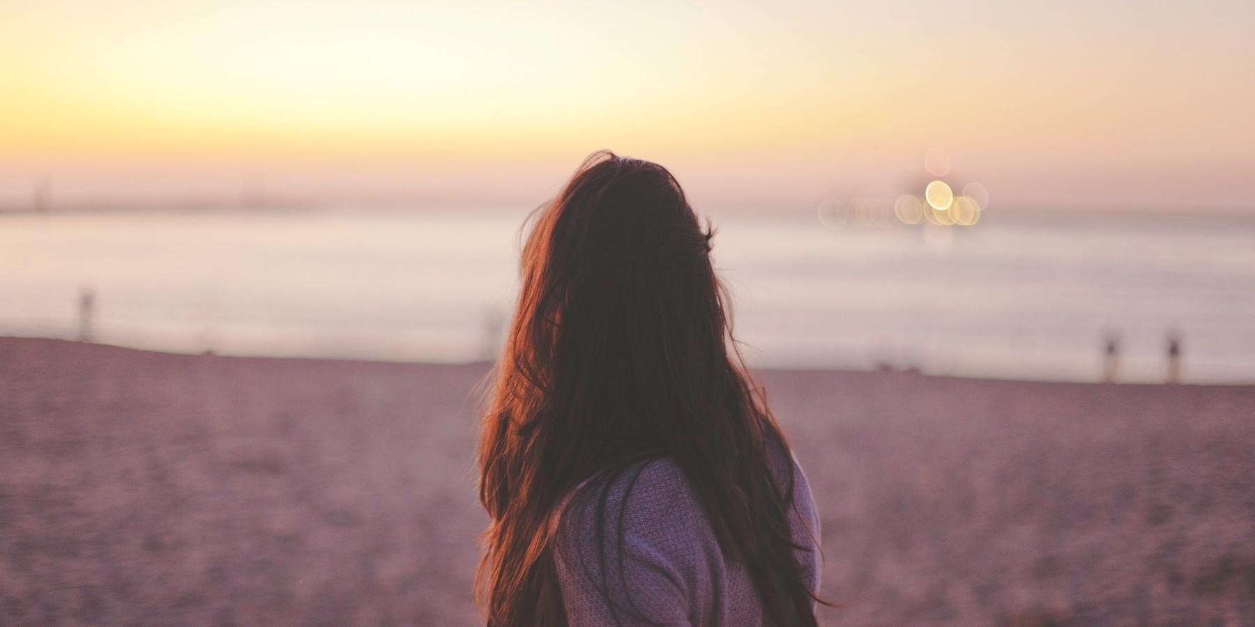 back woman sunset beach
