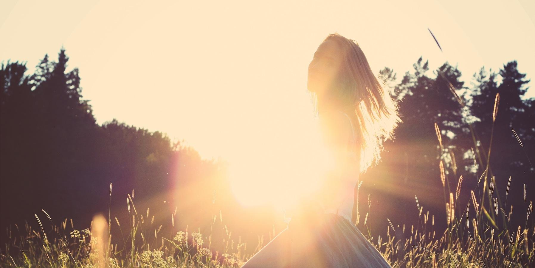 woman twirling in field_afternoon sun copy